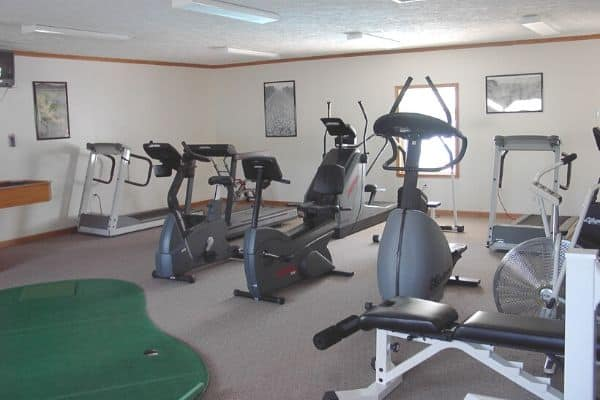 Fitness room with exercise equipment at North Star of Dover clubhouse